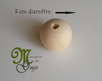 Natural round wooden bead. Diameter 3 cm.