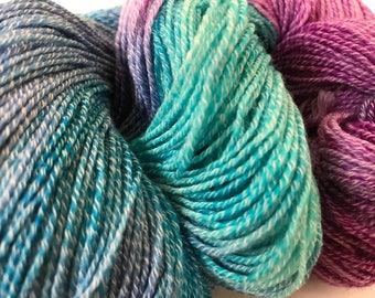Hand dyed Merino and nylon sock yarn in cyan, emerald and magenta