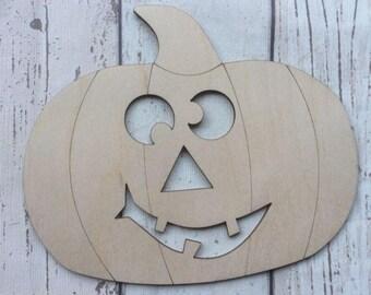 Cute laser cut wood pumpkin heads in packs of three, five or ten