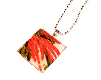 Caribe, pink and green floral design on a silver square resin pendant.