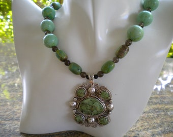 Magnesite beads with hand wrought sterling silver pendant with turquoise in resin