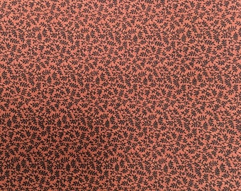 Printed Cotton Fabric of Mini Black Leaf Clusters on a Burnt Orange Background, #dr180