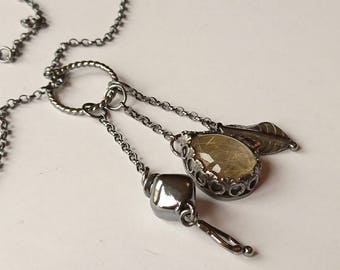 Sterling silver handmade golden rutilated quartz necklace with leaf charms, oxidised. Hallmarked in Edinburgh.