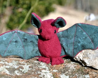 Red and green plush Bat