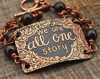 We Are All One Story bracelet, dark red garnet beads and etched copper, phrase jewelry, 7 1/2 inches long