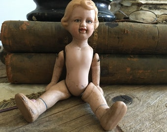 Former articulated doll.