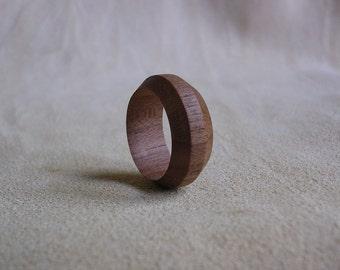 Handmade wooden ring, turned in Italian walnut.