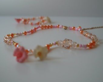 """Hodge podge """"luck"""" necklace + its elastic strap."""