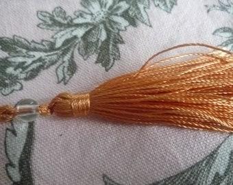 Orange yarn tassel and bead faceted - 6 cm