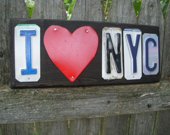 I love NYC license plate sign.