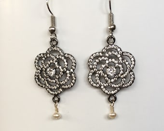 Camelia flower in gunmetal grey dangle earrings with pave rhinestones, rhinestone center and wire wrapped drop seed pearl