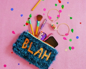 Furry crochet clutch, purse, make-up bag, pencil case, in blue and orange with crocheted 'BLAH' lettering