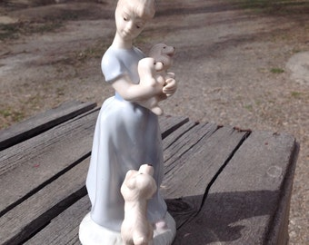 Girl and puppies figurine