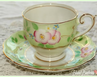Bell China, England: Charming tea cup and saucer, with hand painted flowers