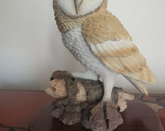 """Tawny Owl perched on a log from the """"leonardo collection"""" on wooden plinth   8 inches"""