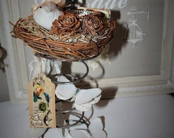 Candle in a rustic nest on spring