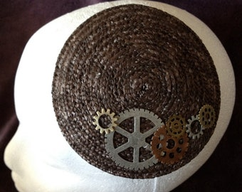 Braided straw fascinator with metal gears and cogs