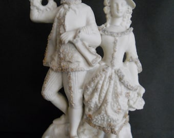 Parian Ware Victorian Lady and Gent Figurine with Astrican Trimming. c 1861.