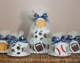 Sports themed diaper cake centerpiece and four smaller cakes