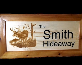 Laser engraved wood sign with Deer and family name.
