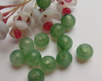 set of 12 green plastic round beads