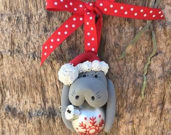 Santa Manatee Holding White Christmas Ball Ornament