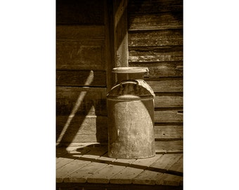 Vintage Creamery Milk Can in Sepia Tone by the old homestead in 1880 Town in South Dakota No.SP8082 A Fine Art Still Life Photograph