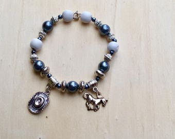 Bracelet with silver themed charms: horse.