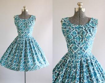 Vintage 1950s Dress / 50s Cotton Dress / Teal and White Floral Print Dress w/ Shelf Bust S