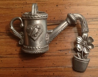 Vintage GARDENERS DELIGHT pewter pin with watering can, flower and bird