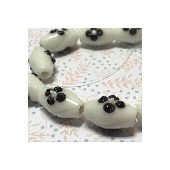 White Oblong Tube Lampwork Beads with Brown/black Flowers approx. 20 x 10mm 11 strung beads