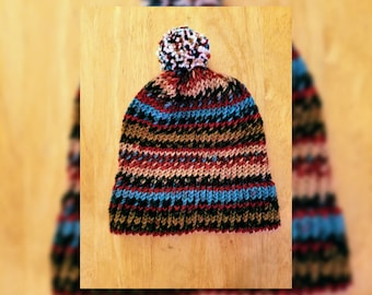 Handmade knitted hat with pompom