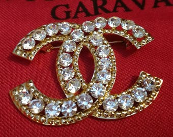 Fashion Elegant Rhinestone encrusted Designer inspiration pin brooch