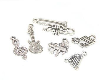 6 charms shaped silver colored variegated //lot musical instruments