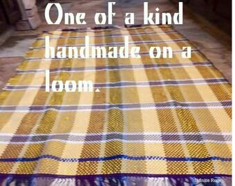 Yellow and tan rag rug