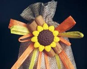 Wedding favor communion-confirmation jute bag with cinnamon and sunflower