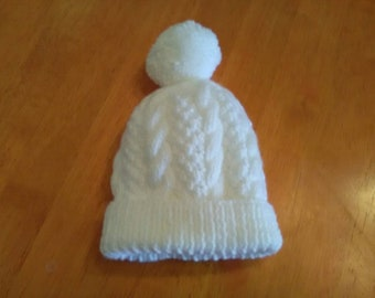 hand knitted cable baby hat in various colours