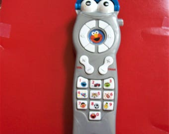 Sesame Street remote control, Elmo silly sounds toy, kids remote, preschool toy, learning toy