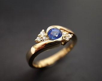 Diamonds Wedding Ring with Blue Sapphire in 14K Yellow Gold