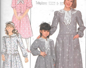 Butterick sewing pattern 5747 for a girls dress size 12-14.