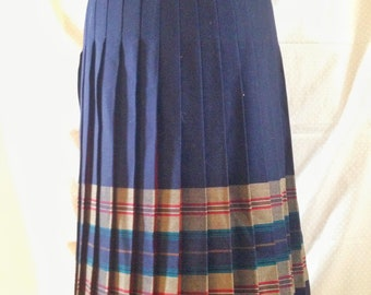 Pure wool 1970's pleated skirt in navy. Modern size 8