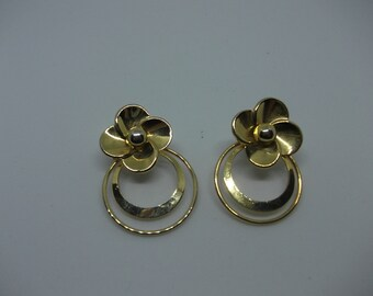 Vintage gold tone clip on forget-me-not flower earrings.