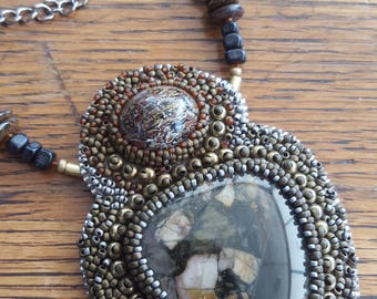 Bead embroidery necklace. Dino. Glass, brass, cabochons.