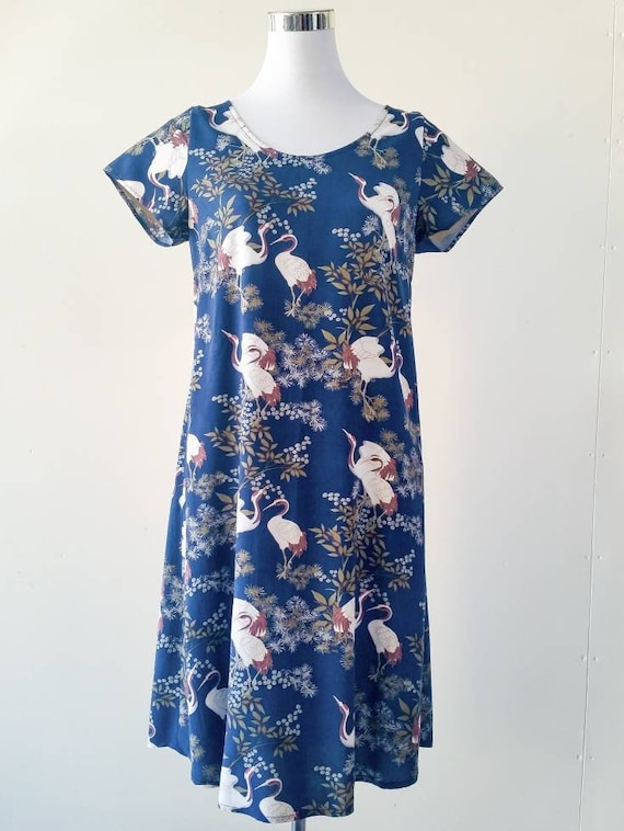 The Ziggy loose fit tunic dress with pockets in 'Cranes in the forest' print