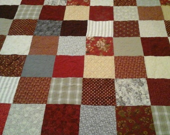 King size red, tan and gray quilt