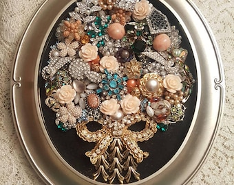 A OOAK Framed Vintage Jewelry Art Picture. Repurposed vintage-rhinestone-jewelry collage-assemblage -tree motif-matte gold tone oval frame