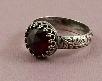 Faceted garnet ring.  Renaissance style.  Sterling silver.  US size 7 3/4.  January birthstone ring.  Medieval. Dark red gemstone ring