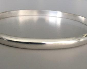 Solid silver bangle. Domed silver bangle. Plain silver bangle. Sterling silver bangle. Simple silver bangle