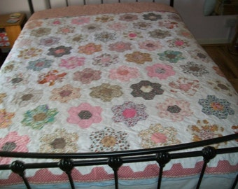 Handmade VINTAGE hand pieced patchwork, newly remade into a double size quilt