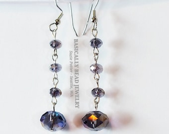 """These 2"""" long hand chained earrings are made with 14mm & 6mm lavender sparkly glass rondelles on surgical steel earwires"""
